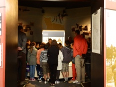 A group of school children enjoy learning about the 6th Airborne Division