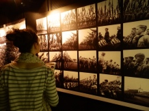 Kate looking through images of taken of the Hitler Youth