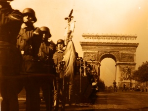 German soldiers marching past the Arc de Triomphe after the surrender of Paris